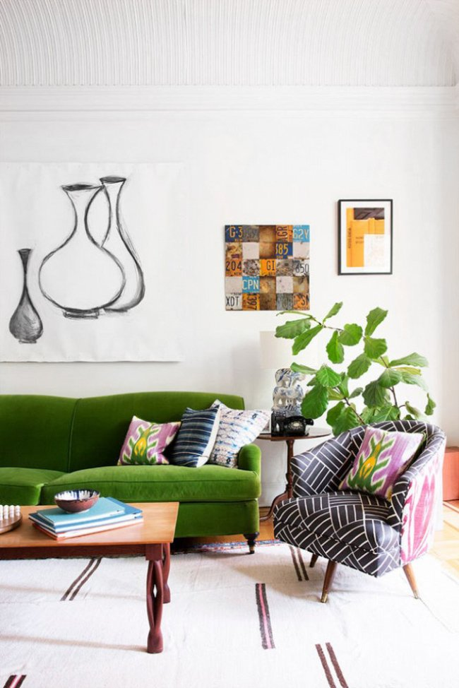 Tips for mixing pattern with Steve McKenzie, Green velvet sofa in a bohemian living room on @thouswellblog