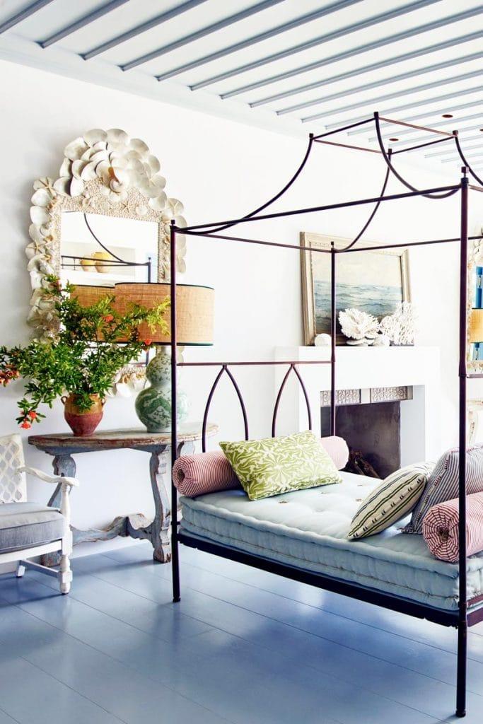 Metal canopy daybed in a Mediterranean living room via Thou Swell #daybed #villa #livingroom #livingroomdesign #interiordesign