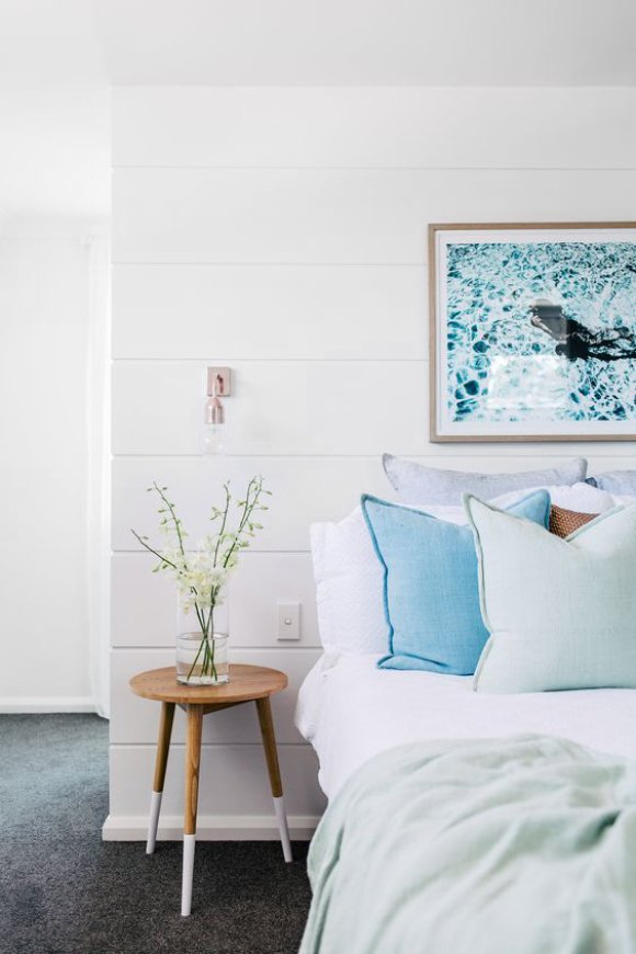 Minimal bedroom with shades of light blue and shiplap walls via @thouswellblog