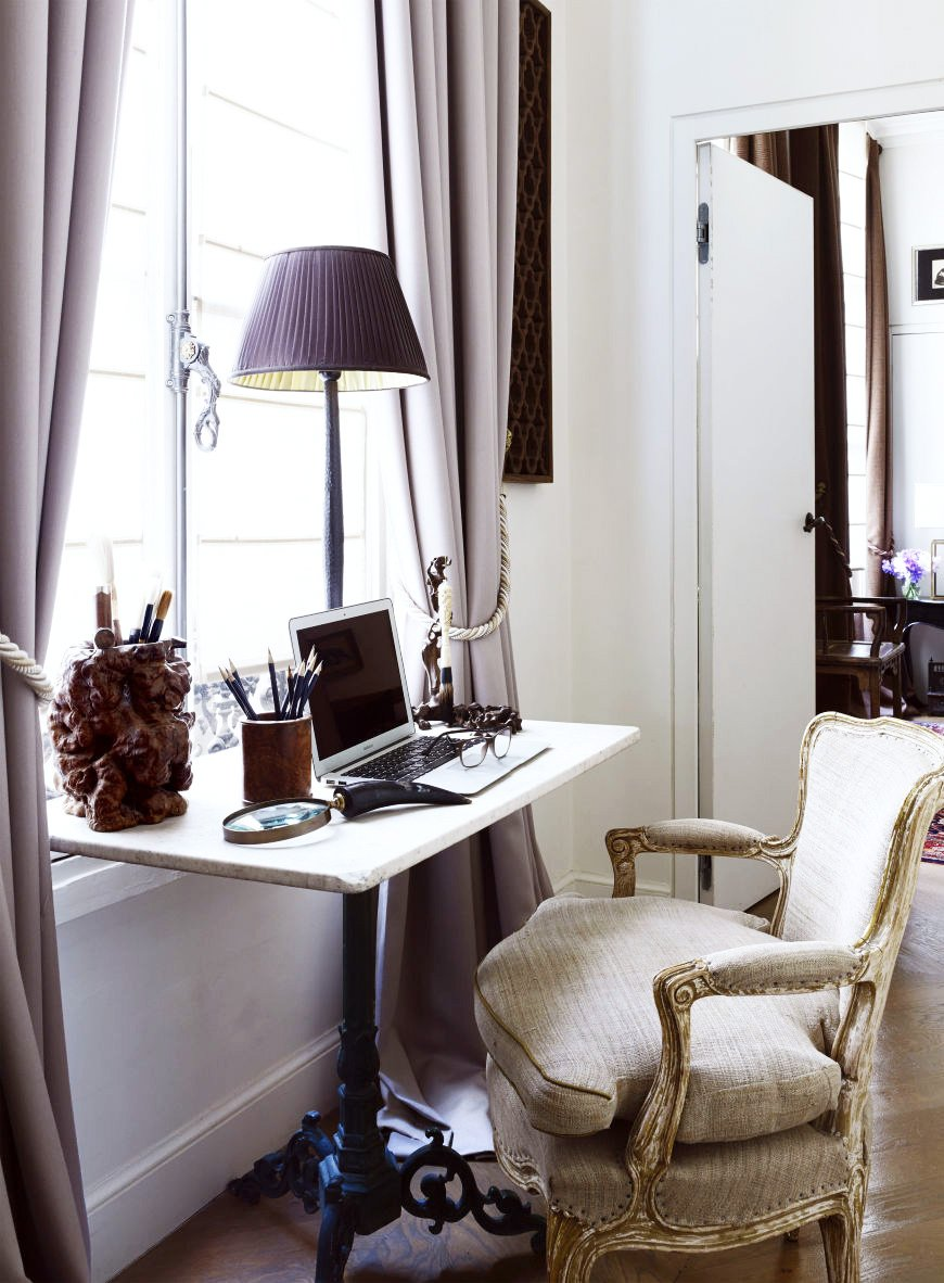 Desk with home office in the window and French armchair in a Paris apartment via @thouswellblog
