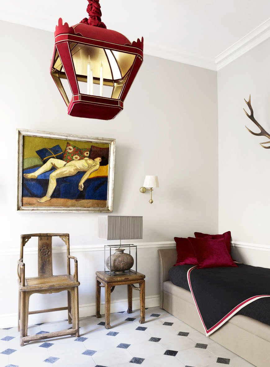 Red lantern and daybed in a glamorous Paris apartment via @thouswellblog