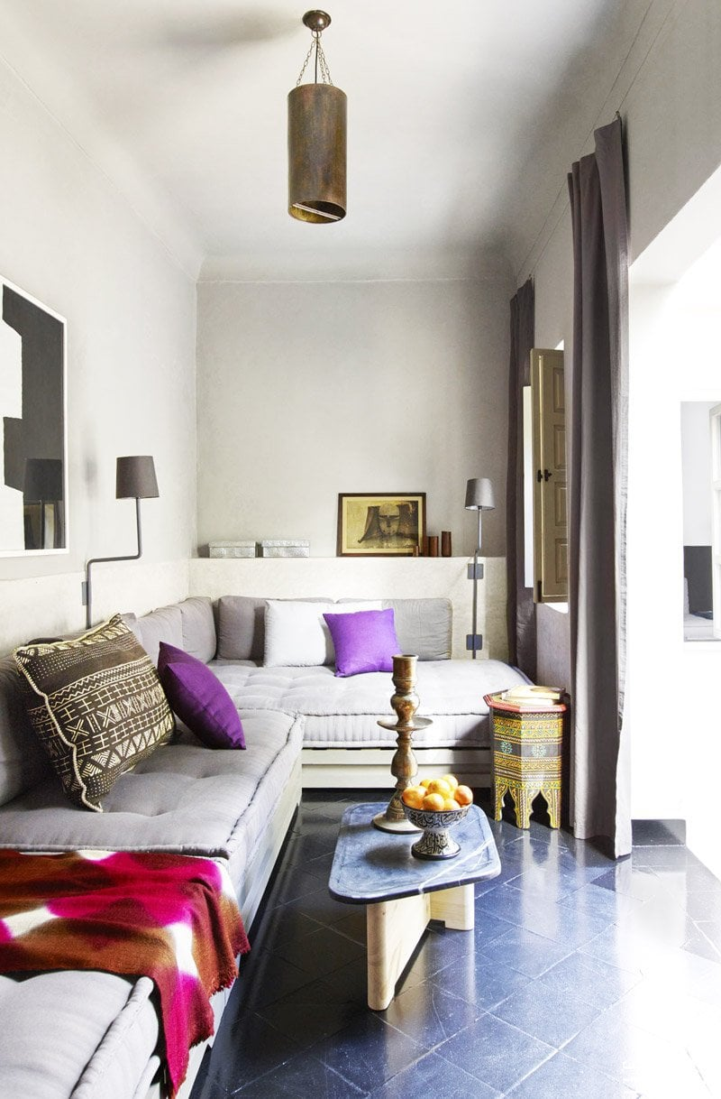 Banquette seating in a graphic style Moroccan riad via @thouswellblog