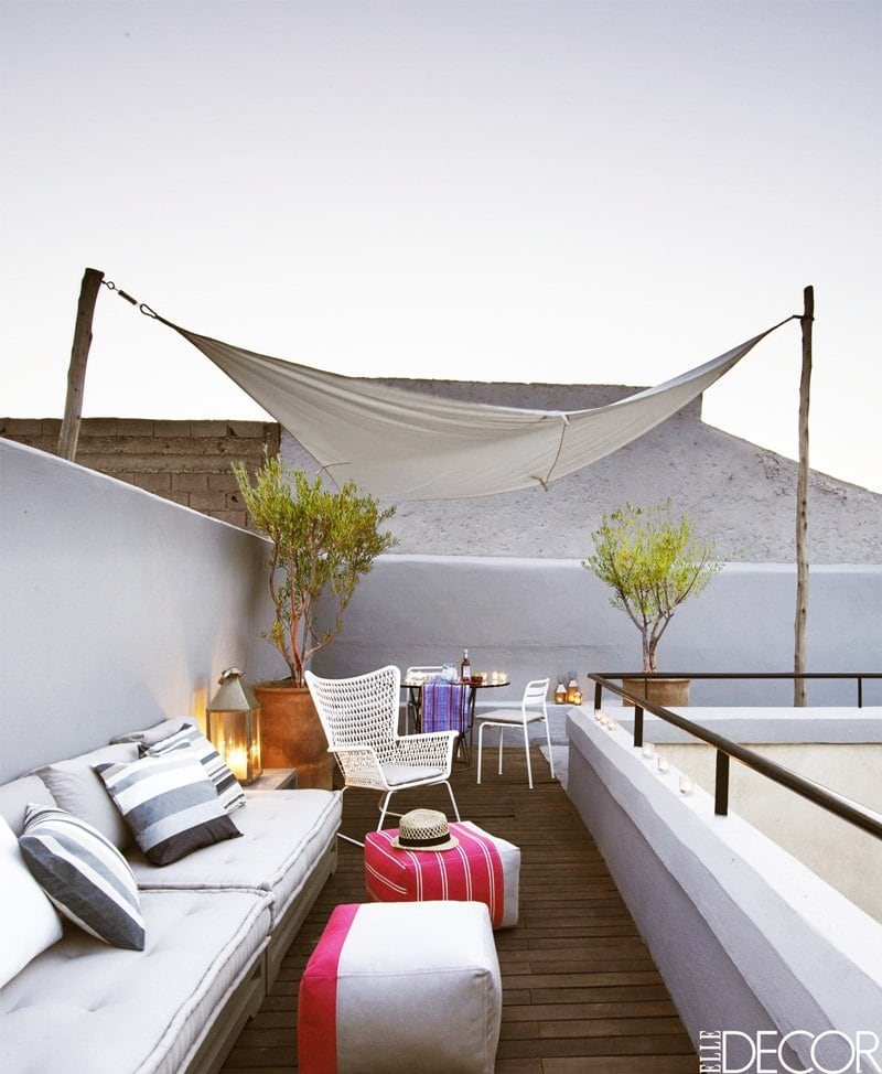 Modern roof deck outdoor seating in a Moroccan riad via @thouswellblog