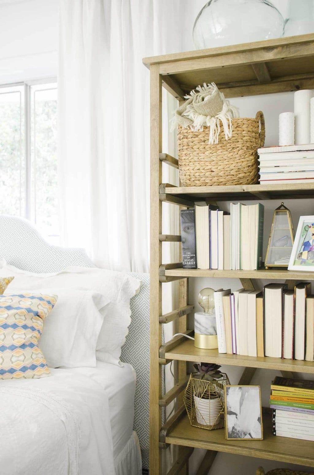 Bookshelf styling beside the bed via @thouswellblog