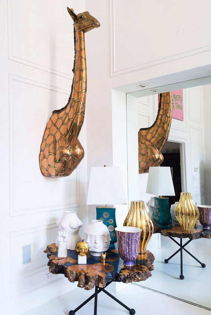 Giraffe on the wall in the dining room of Jonathan Adler's NYC home on @thouswellblog