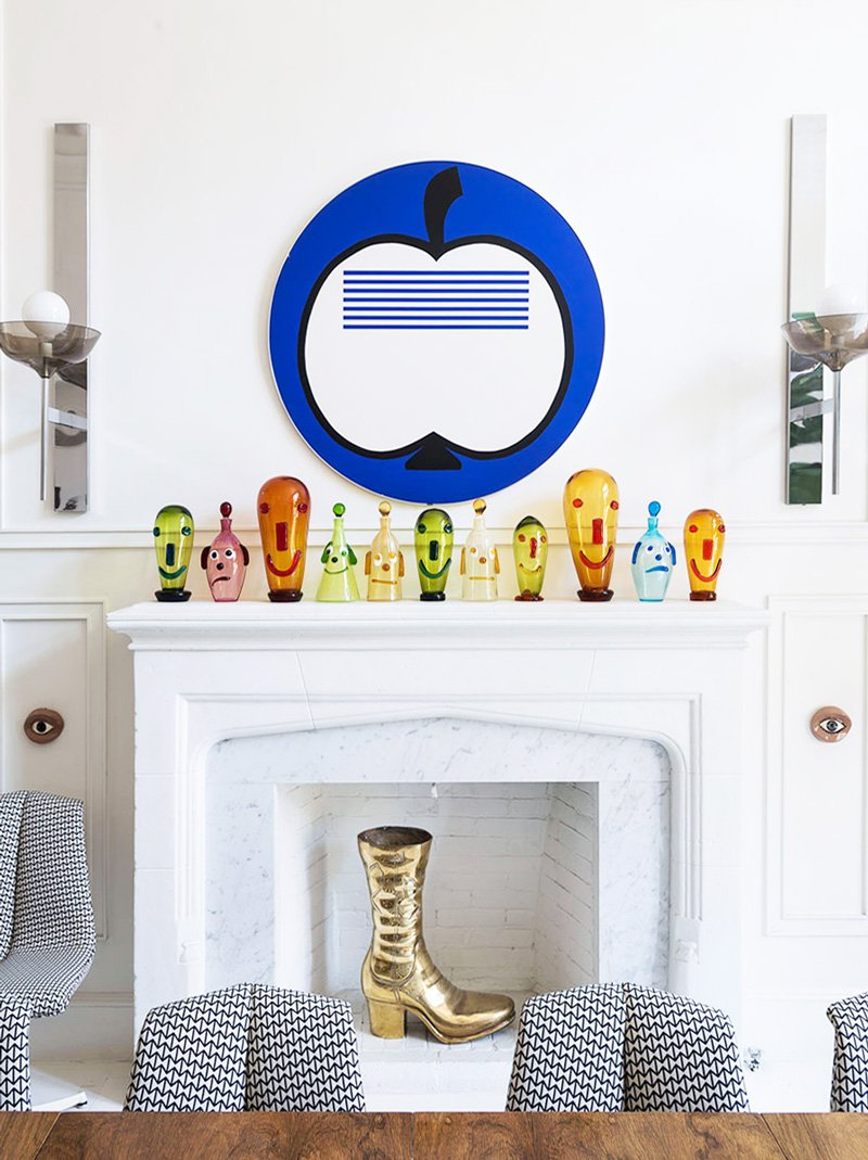 Modern mantel styling with modern art and gold boot in the fireplace via @thouswellblog