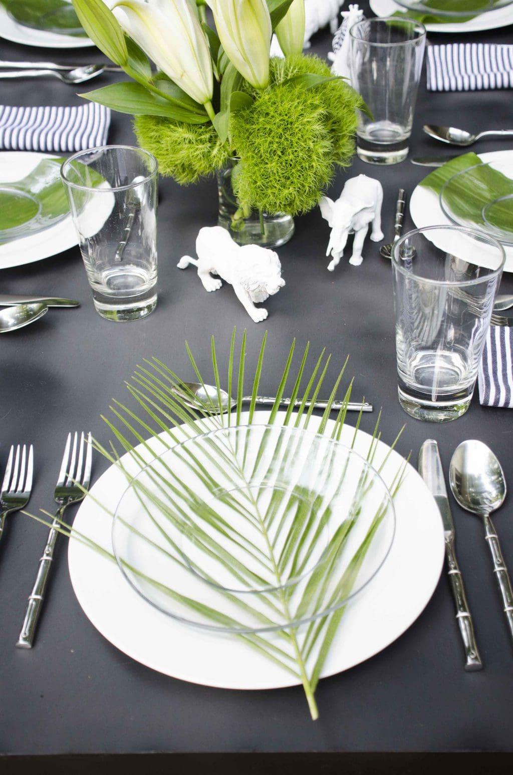 Black and white table setting with safari animals via @thouswellblog