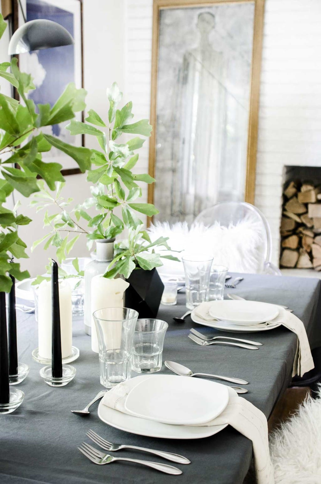 Scandinavian-inspired black, white, and grey summer table setting with simple green arrangements via @thouswellblog