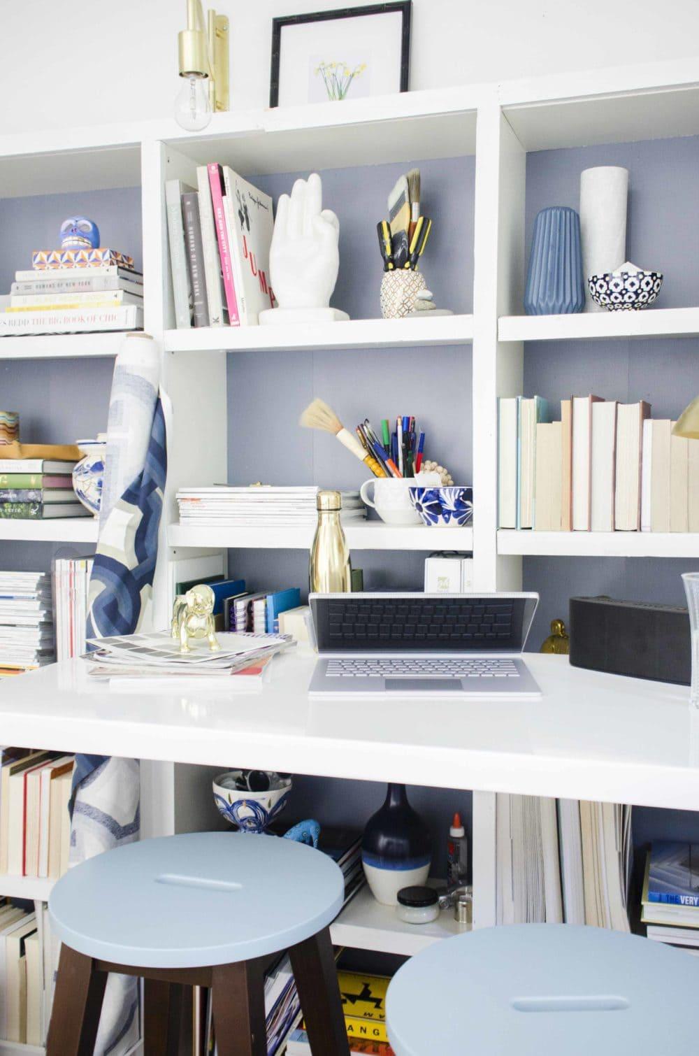 Modern standing desk home office with bookshelves on @thouswellblog