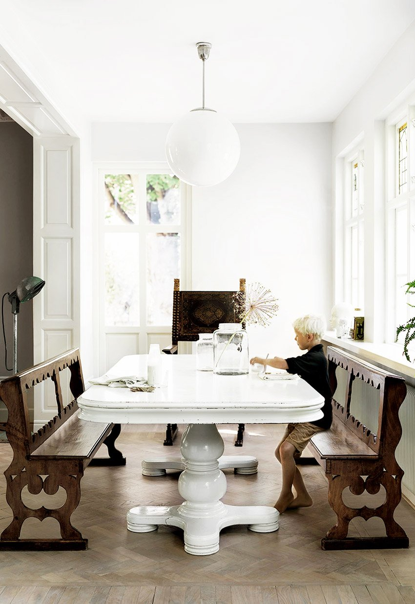 Antique dining benches in European dining room via @thouswellblog