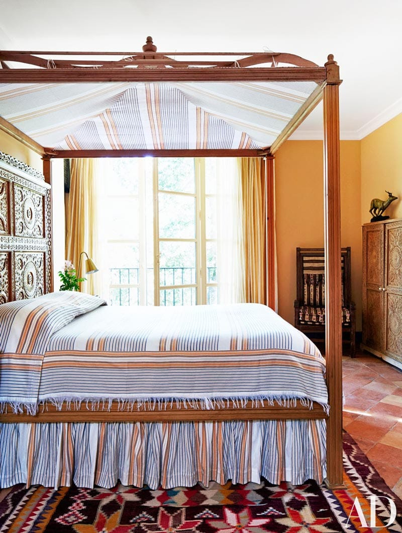 Moroccan textiles on a canopy bed in a French bedroom in Provence via @thouswellblog
