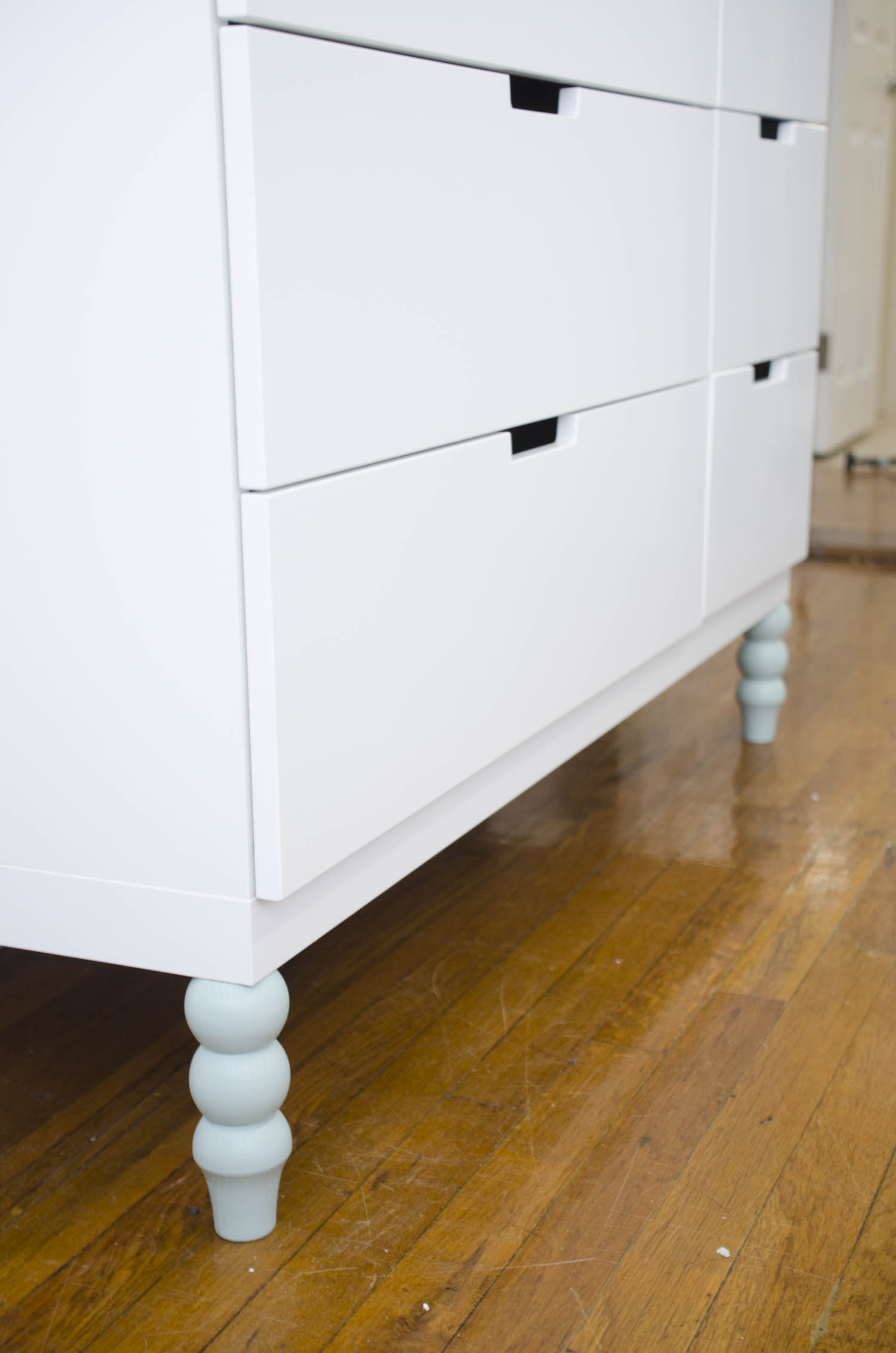 Modern white dresser with blue legs by PrettyPegs  via @thouswellblog