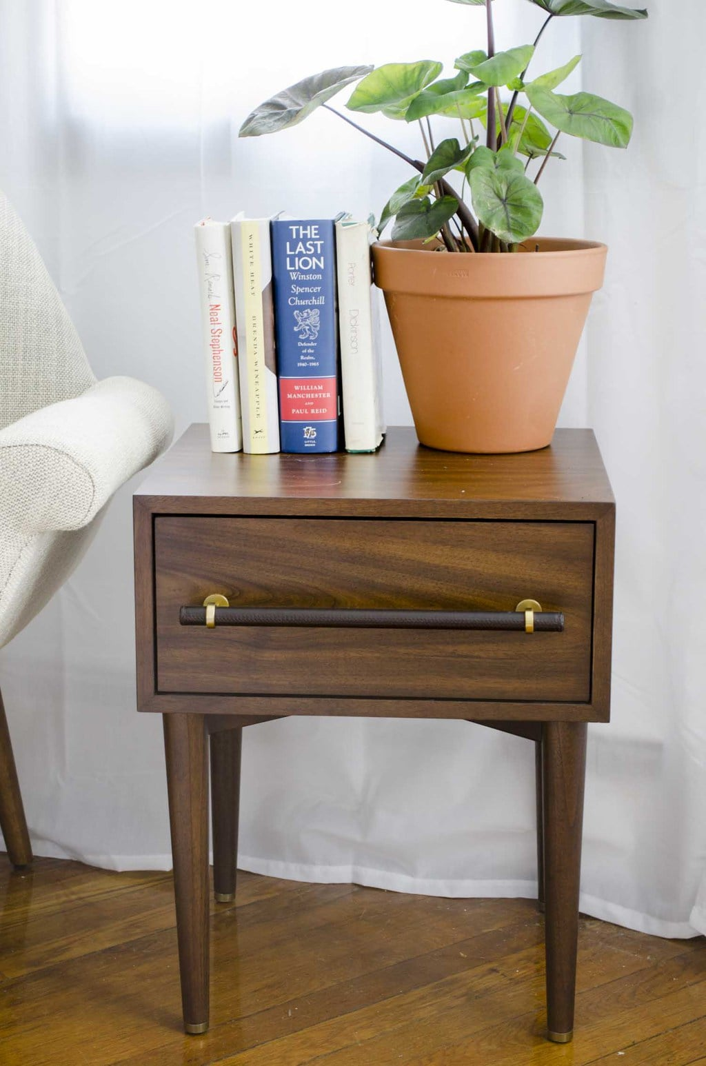 Walnut mid-century side table with leather pull by west elm on @thouswellblog