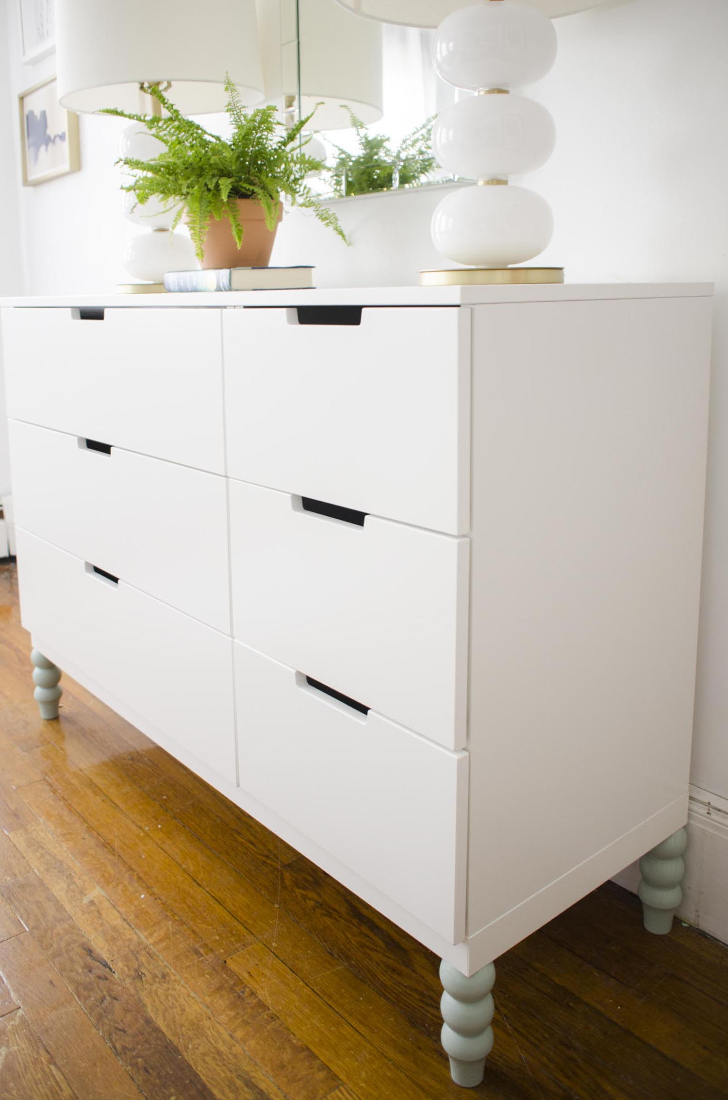 Modern white dresser with blue legs via @thouswellblog