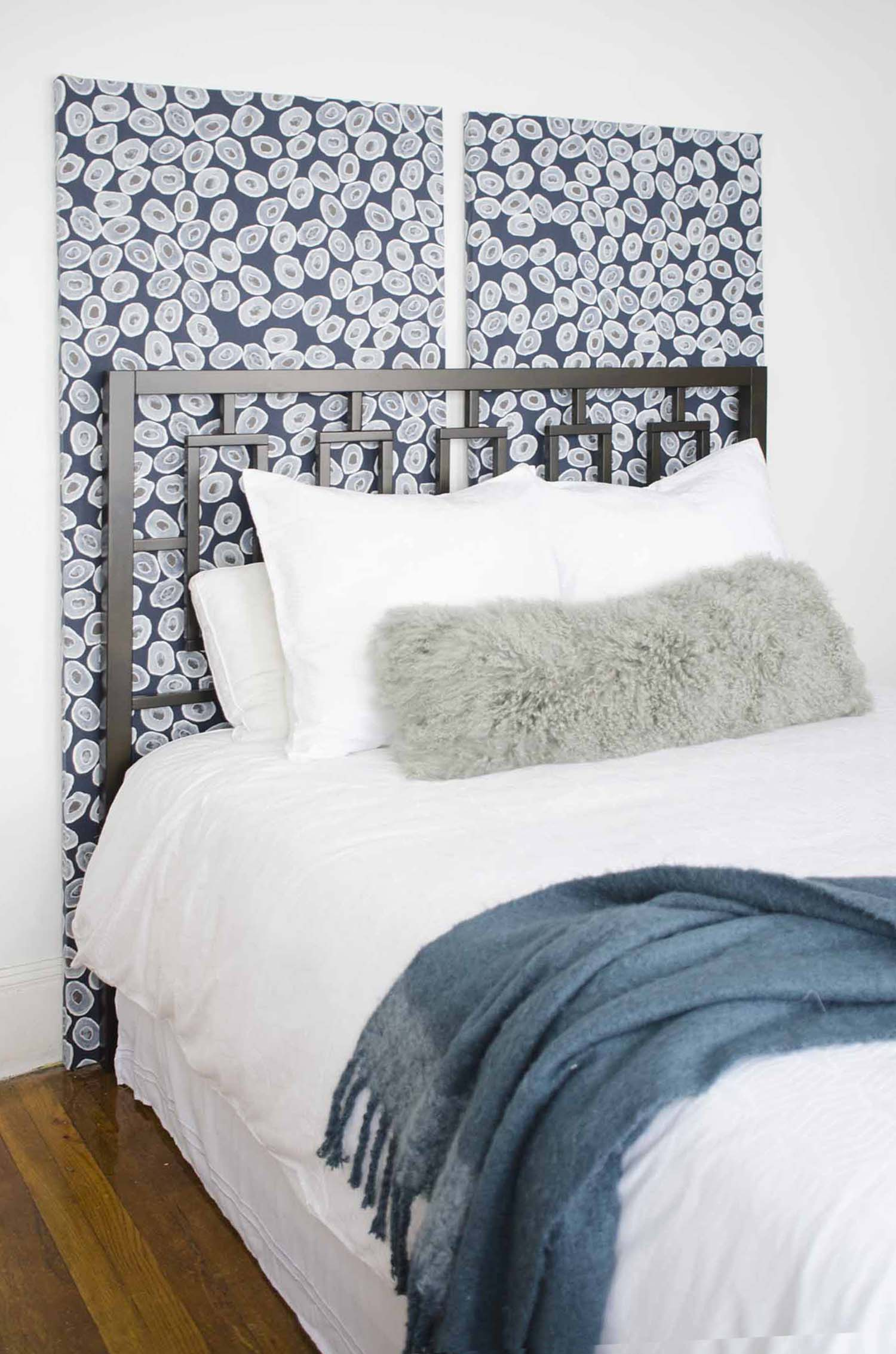 Renter-friendly wallpaper panels in a bedroom makeover on @thouswellblog