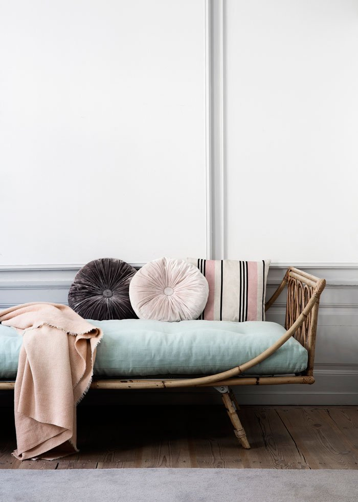 Rattan daybed styled with pillows and a throw via @thouswellblog
