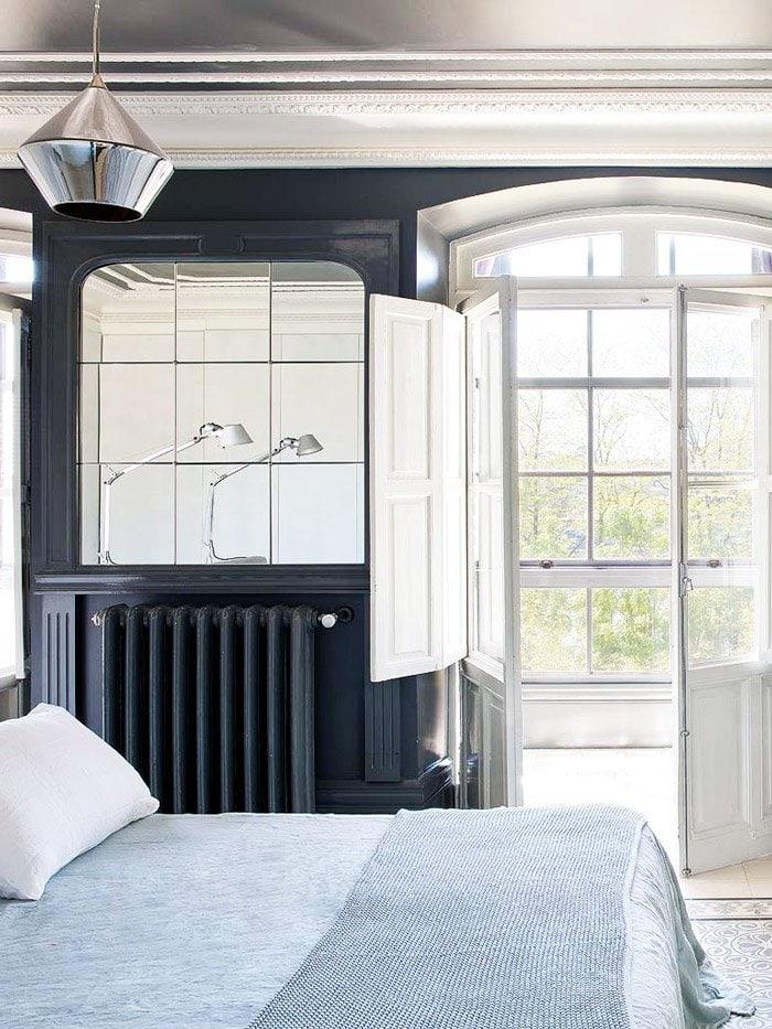 Navy blue bedroom walls in eclectic home in Spain via @thouswellblog