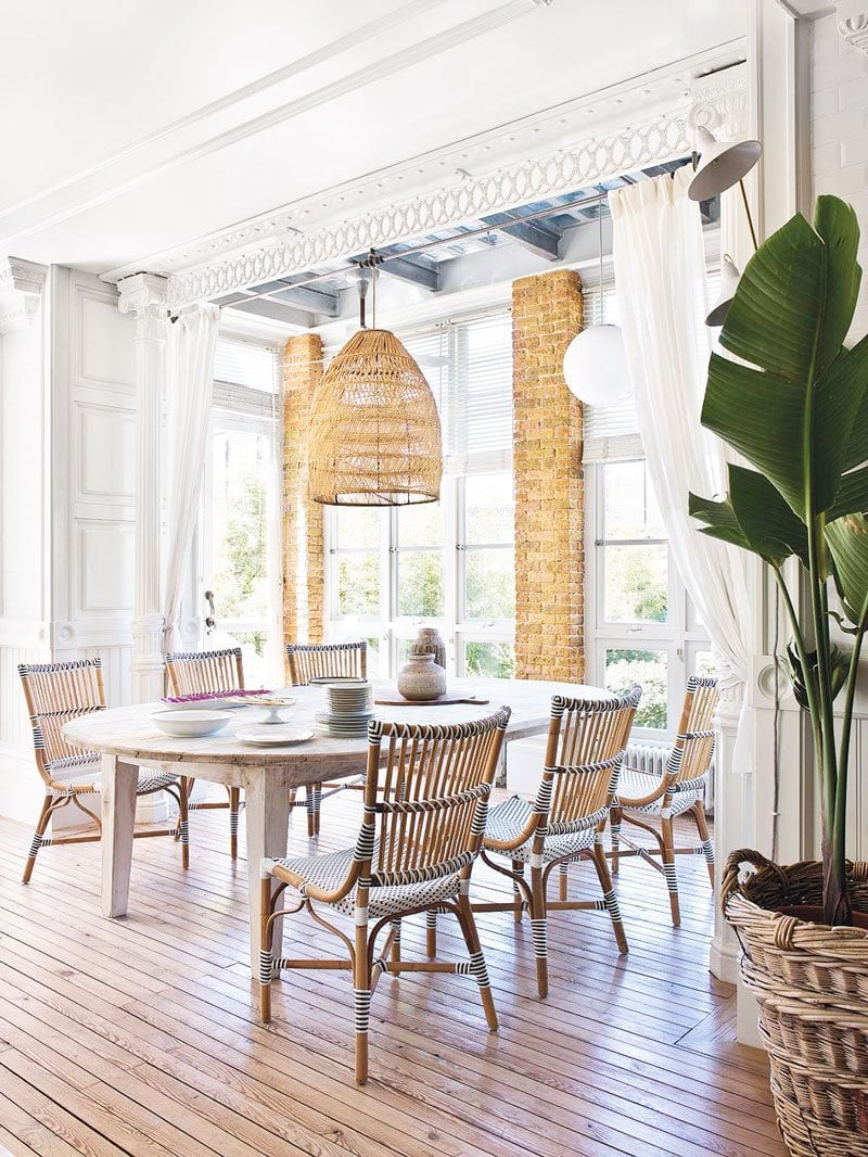 Eclectic loft-style dining room with wicker chairs via @thouswellblog