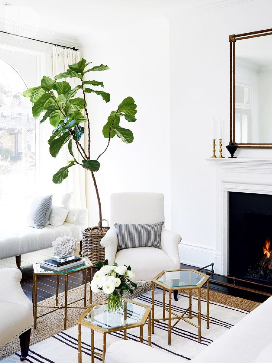 Bright and airy living room makeover with black, white, and gold via @thouswellblog
