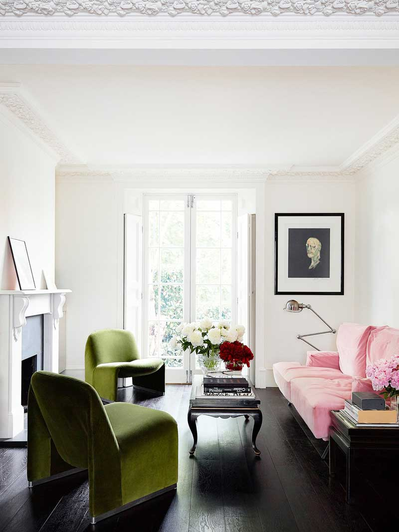 Modern living room in London with green velvet chairs via @thouswellblog