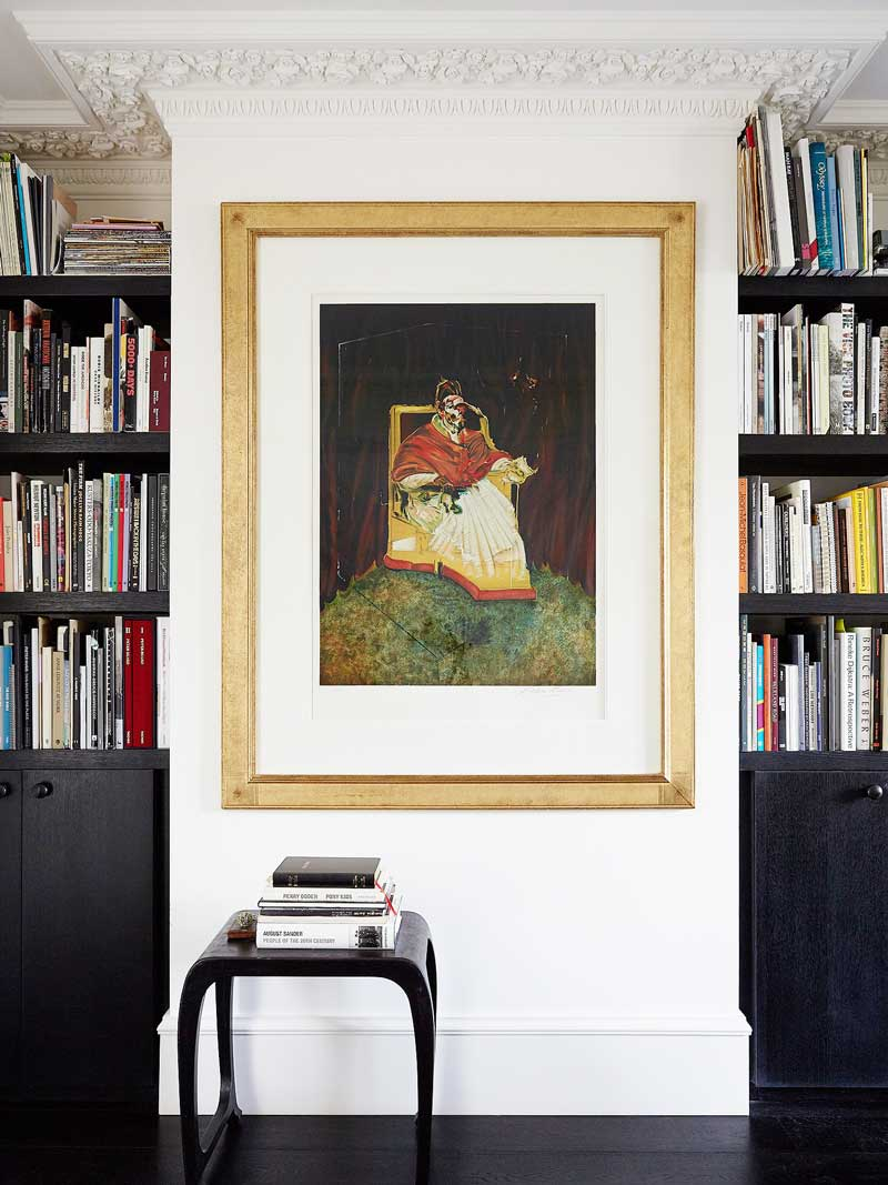 Built-in bookshelves with gold-framed artwork via @thouswellblog