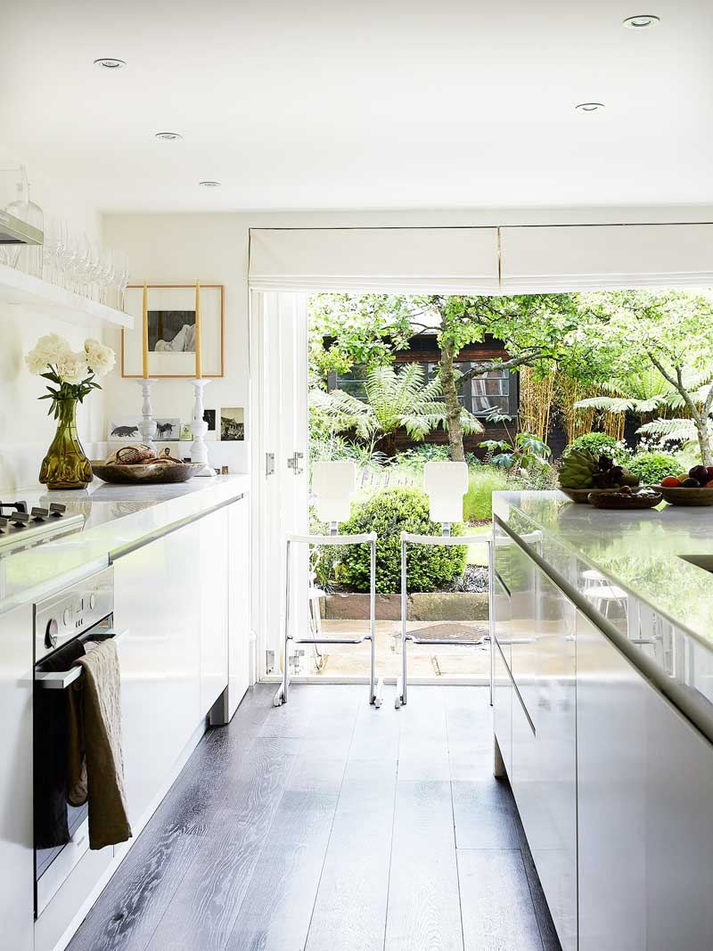 Clean modern kitchen in London with white cabinetry via @thouswellblog