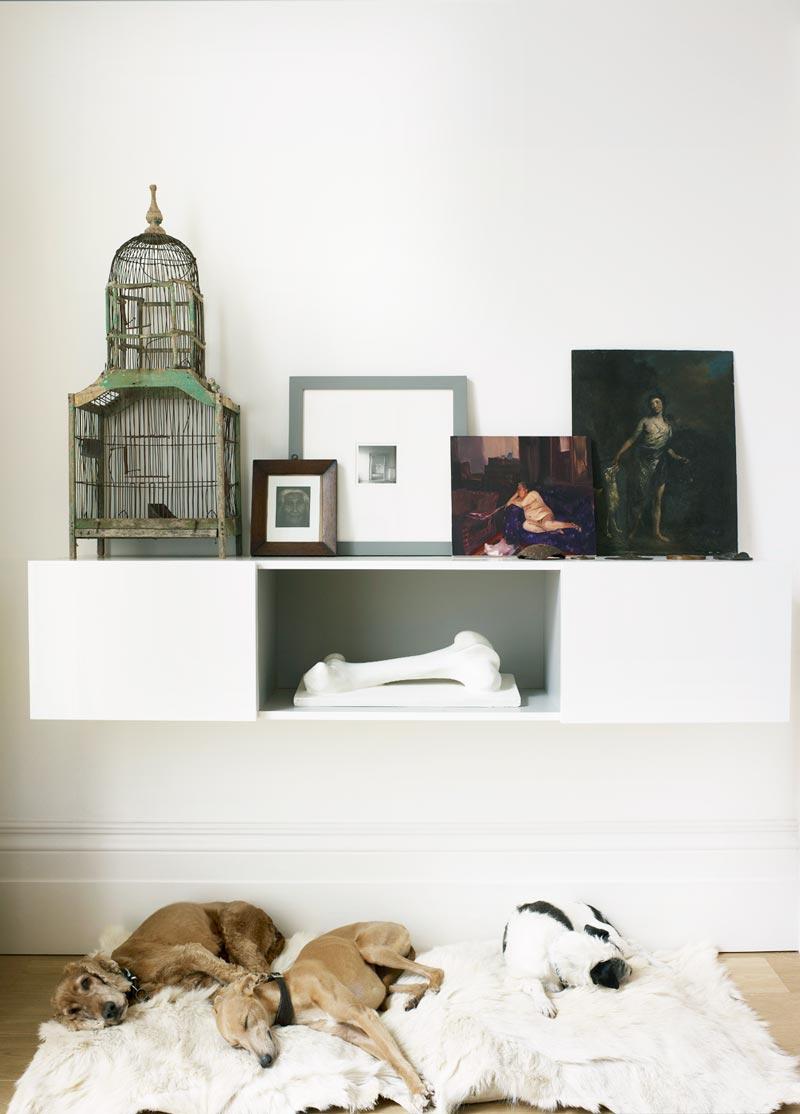 Dog beds under a floating shelf via @thouswellblog