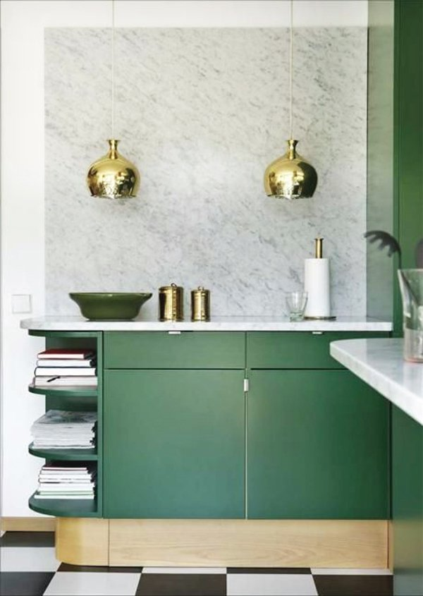 Green cabinets with gold pendants in a modern kitchen via @thouswellblog