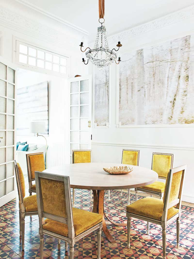 Dining room with yellow velvet dining chairs via @thouswellblog