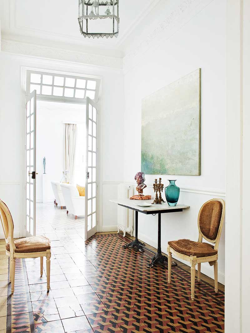 Eclectic entryway with tiled floor in Spanish apartment via @thouswellblog