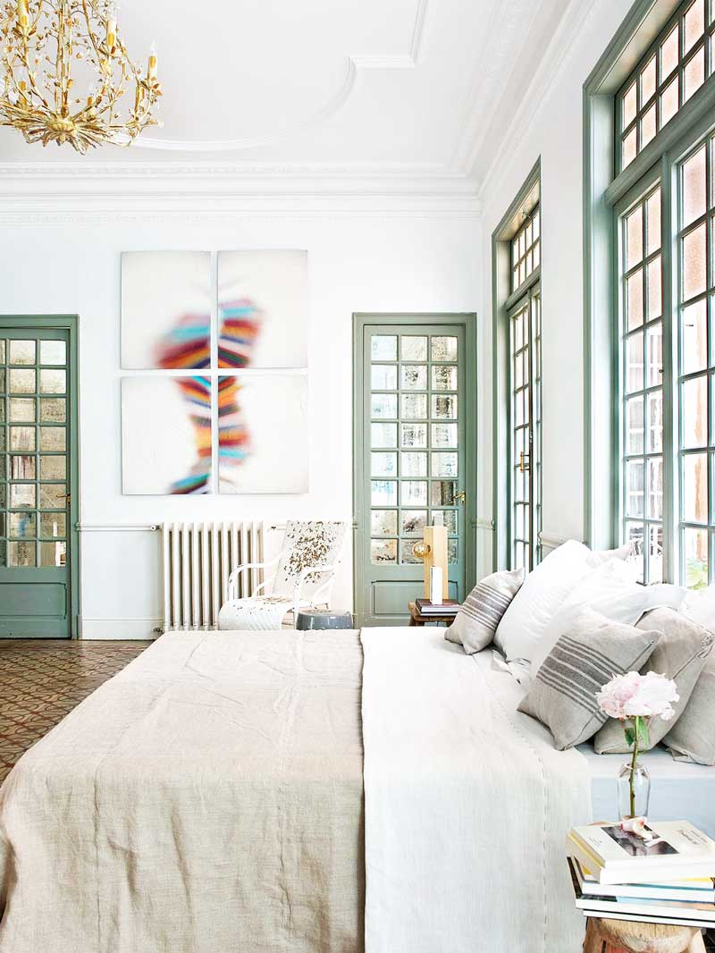 Airy bedroom with large windows and linen bedspread in Spanish apartment via @thouswellblog