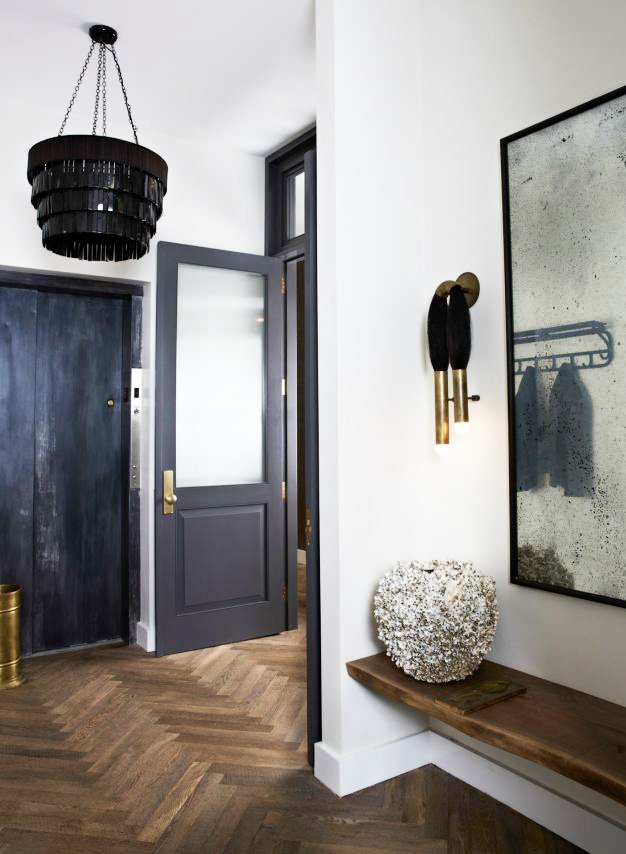 Modern entryway with sculpture and sconces in a Soho loft via @thouswellblog