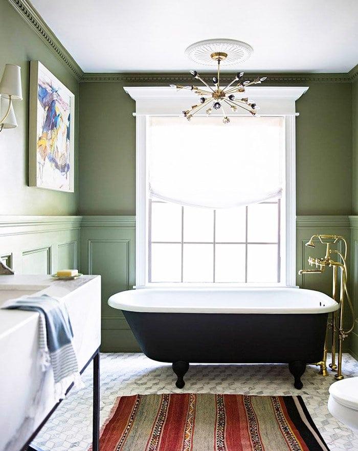 Olive green bathroom with black clawfoot bathtub on @thouswellblog