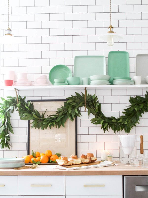 Garland in the kitchen with colored plates and holiday brunch via Oh Happy Day on Thou Swell