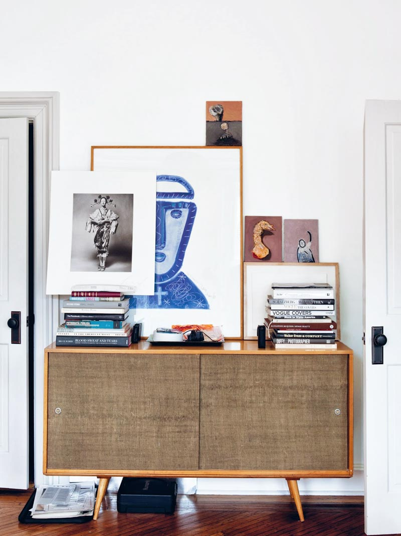 Modern credenza with books and artwork on Thou Swell