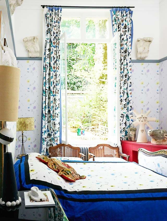 Patterned bedroom in an eclectic French apartment via Thou Swell