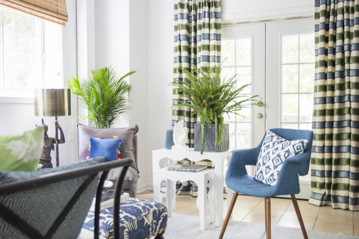 Blue green guest room with fern  palm  and Moroccan side tables on Thou Swell