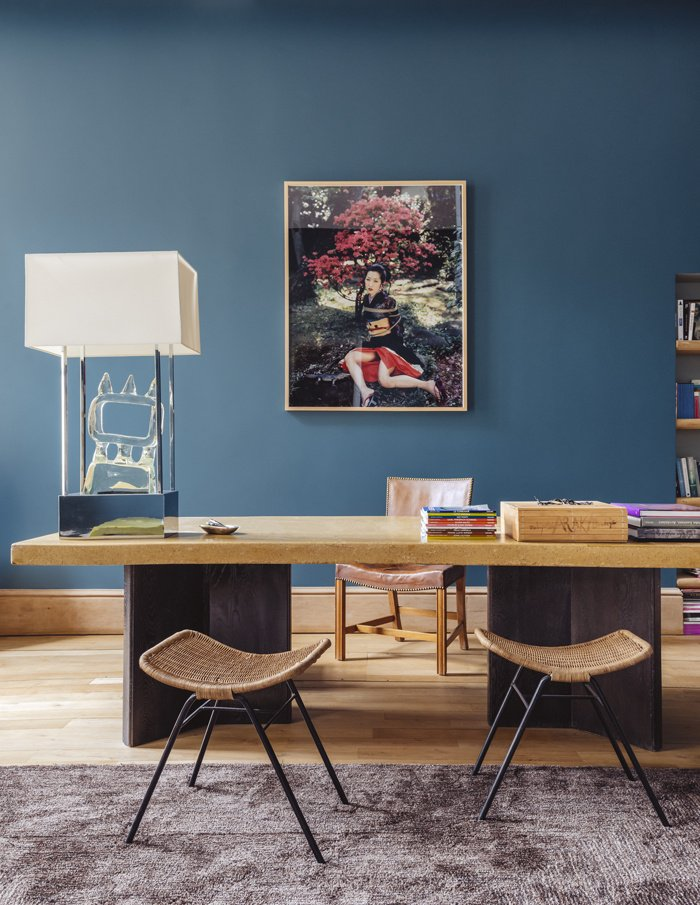 Simple modern home office desk with blue walls and wicker stools on Thou Swell @thouswellblog