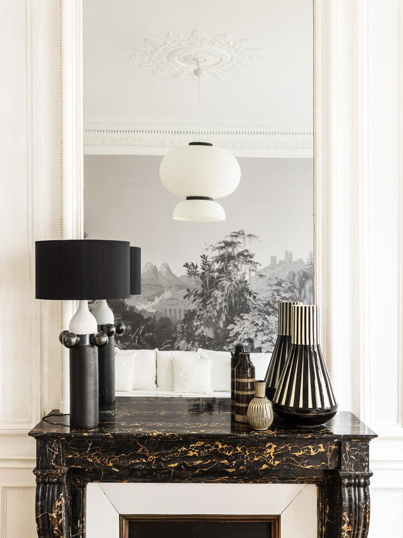 Black and white fireplace vignette with marble mantel on Thou Swell