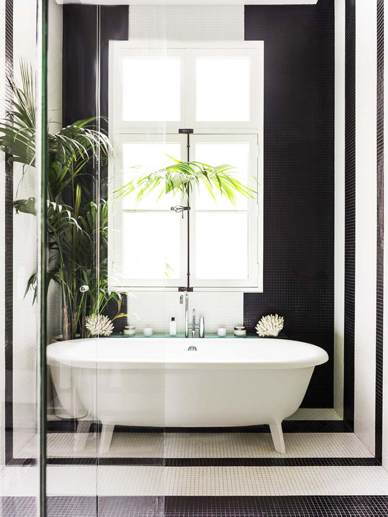 Black and white bathroom with tiled stripes on Thou Swell