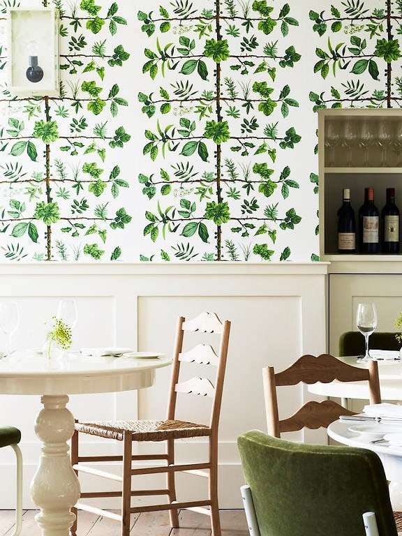 Dining room with Espalier wallpaper by Pierre Frey in Pantone Greenery on Thou Swell