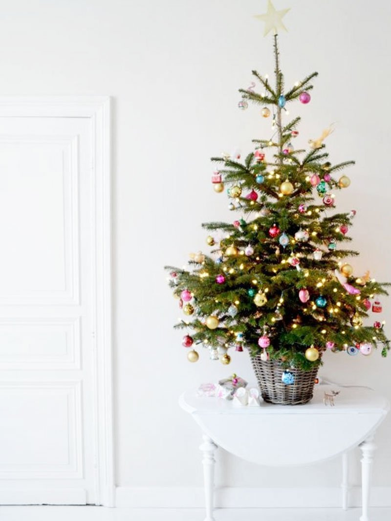 Small space Christmas tree in a wicker basket on Thou Swell