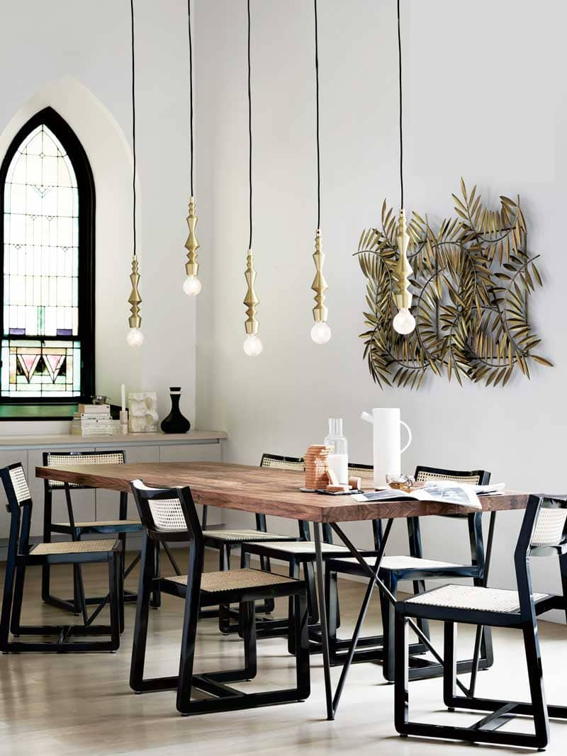 Eclectic global dining room with stained glass window and pendant lights on Thou Swell @thouswellblog