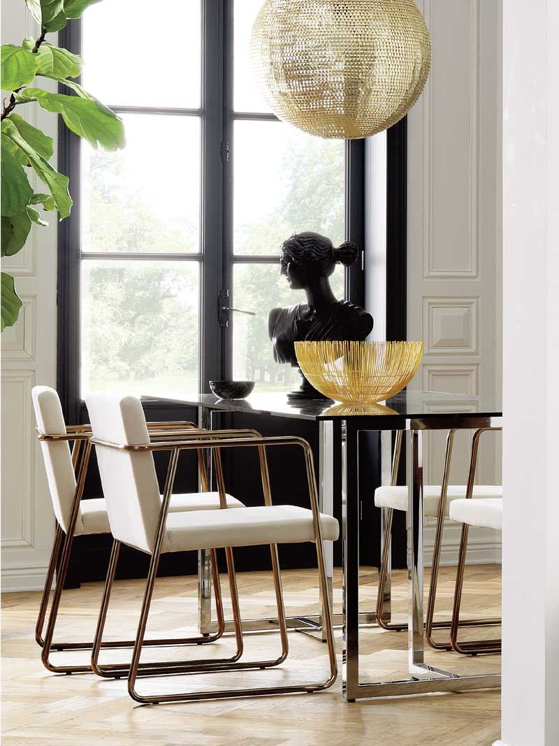 Modern dining room with gold chairs and fiddle leaf fig tree on Thou Swell @thouswellblog