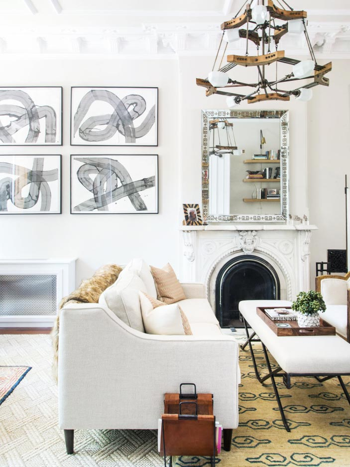 Neutral living room design with black and white abstract art and facing sofas on Thou Swell @thouswellblog