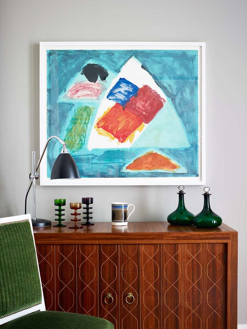 Modern art and mid-century sideboard in a London flat on Thou Swell @thouswellblog