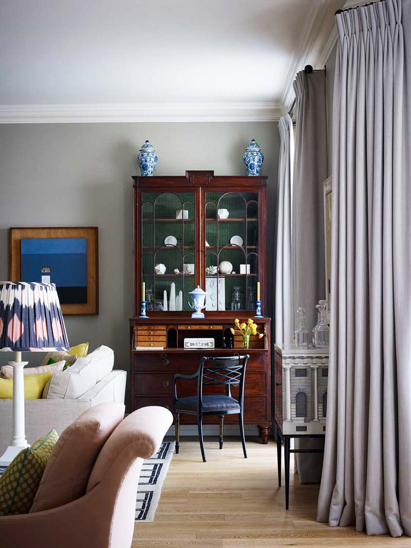 Antique cabinet in the living room of a London flat on Thou Swell @thouswellblog