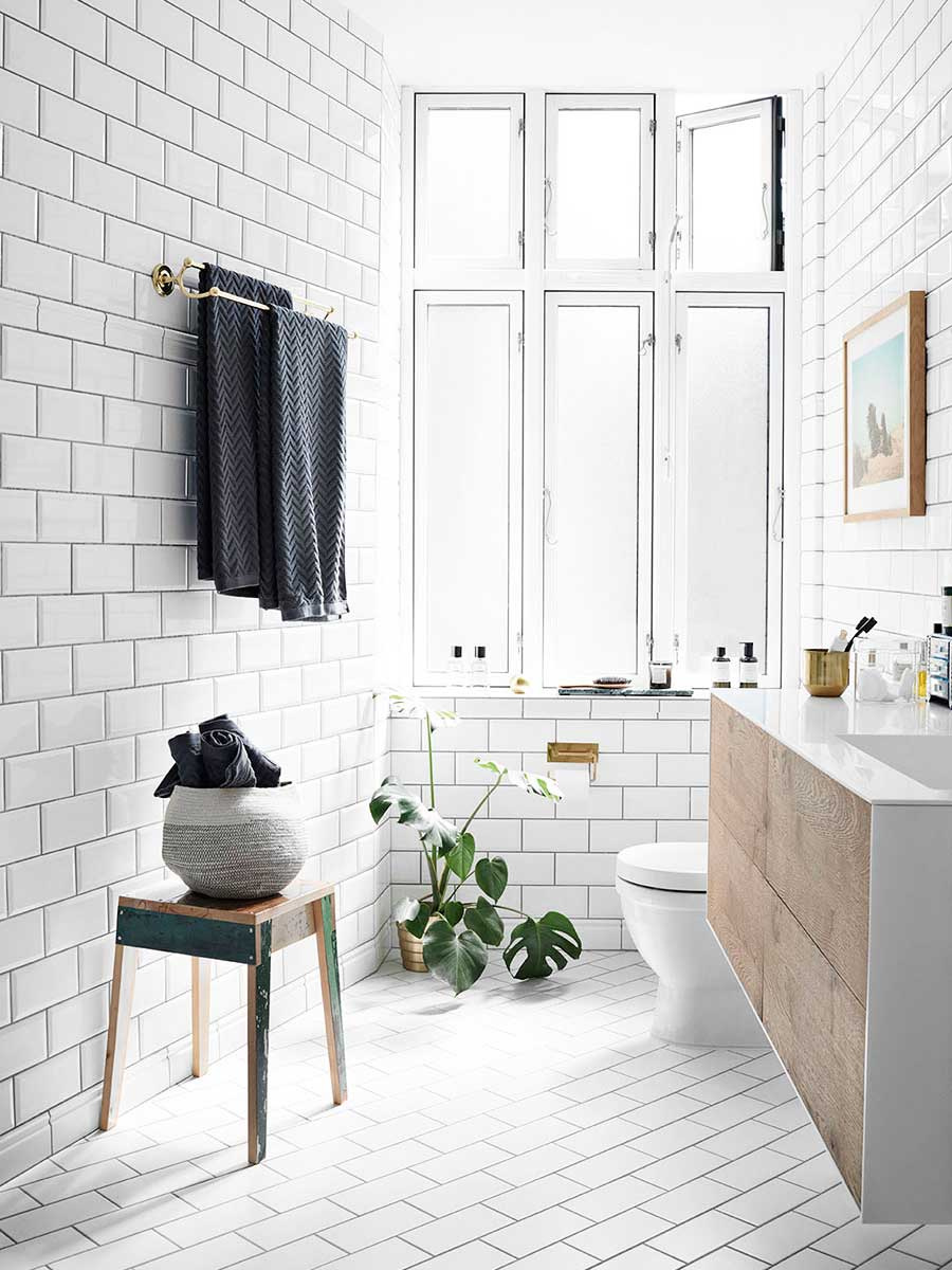 Scandinavian bathroom style with white tile and floating sink via Thou Swell @thouswellblog