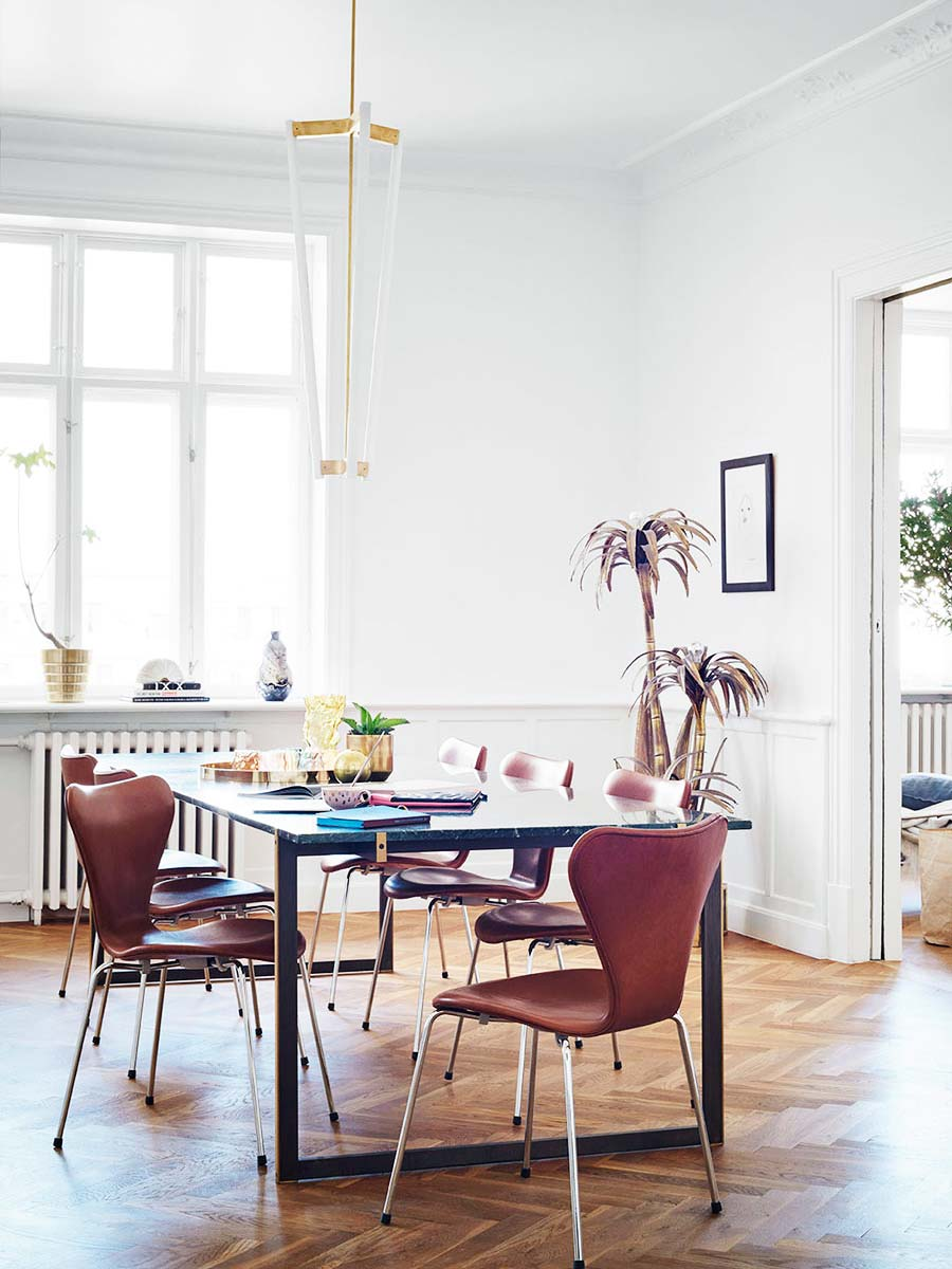 Stylish modern dining room in Denmark with leather chairs and LED light fixture on Thou Swell @thouswellblog