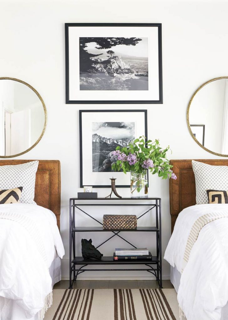 Layered twin bedroom with round mirrors and console table via Thou Swell @thouswellblog